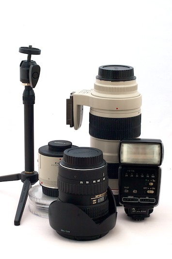 Canon lenses with a flash and a mini tripod