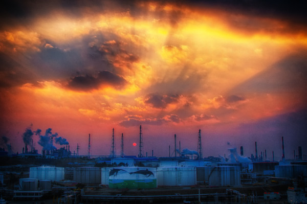 The sun was setting beautifully and I wanted to show the contrast of the natural beauty with the factories. I wanted to focus on the sky and really bring out the colour. Shooting for HDR I wanted a fast shutter speed so that there would not be any movement in the sky. Thus I shot as wide-open as my lens would allow.