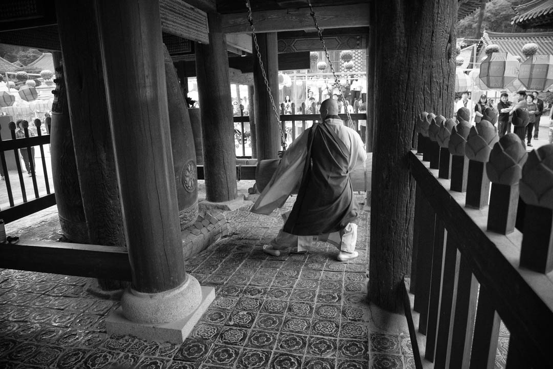 A Monk rings a bell at Tongdosa, a temple in Korea