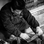 A man sharpens knives in Jagalchi Market in Busan, South Korea